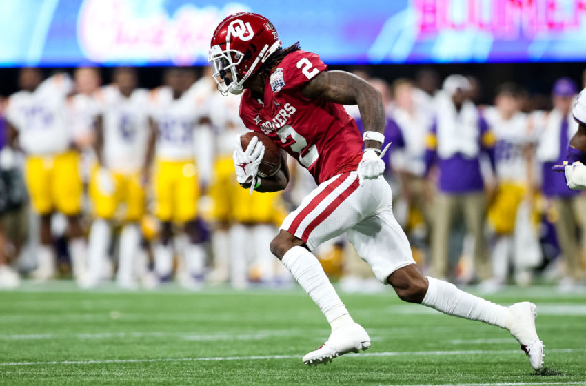 ATLANTA, GA - DECEMBER 28: CeeDee Lamb #2 of the Oklahoma Sooners rushes with the ball during the Chick-fil-A Peach Bowl against the LSU Tigers at Mercedes-Benz Stadium on December 28, 2019 in Atlanta, Georgia. (Photo by Carmen Mandato/Getty Images)