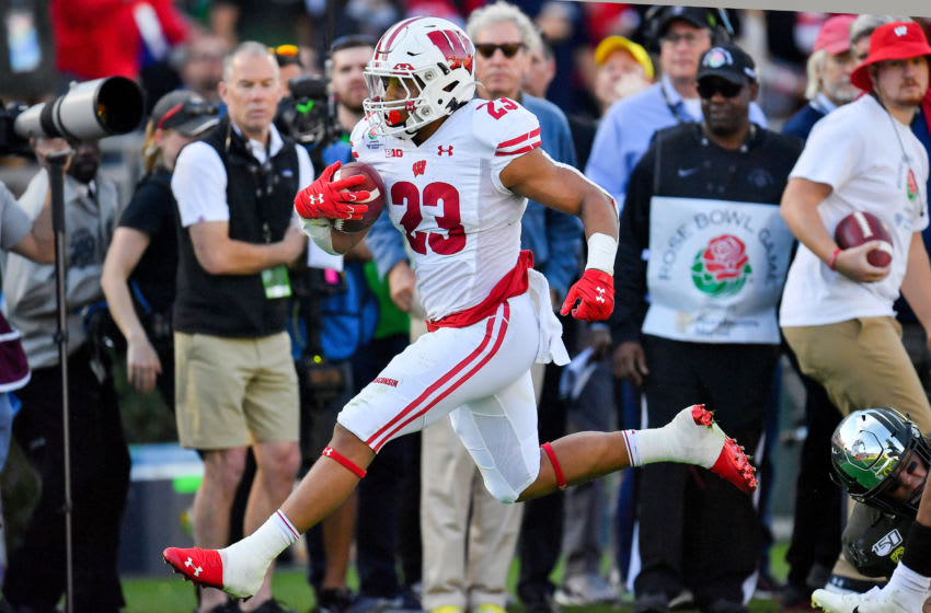 PASADENA, CALIFORNIA - JANUARY 01: Jonathan Taylor #23 of the Wisconsin Badgers runs for a 10 yard gain during the second quarter of the game against the Oregon Ducks at the Rose Bowl on January 01, 2020 in Pasadena, California. The Oregon Ducks topped the Wisconsin Badgers, 28-27. (Photo by Alika Jenner/Getty Images)