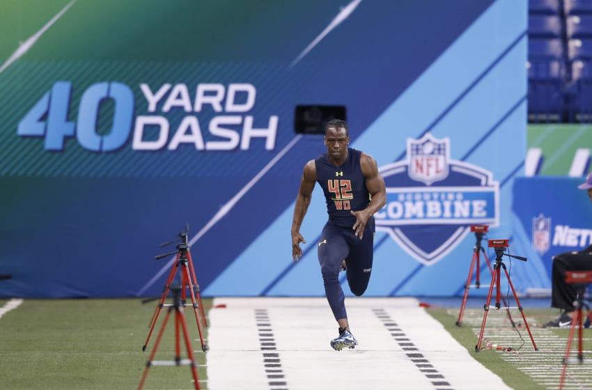 INDIANAPOLIS, IN - MARCH 04: Wide receiver John Ross of Washington runs the 40-yard dash in an unofficial record time of 4.22 seconds during day four of the NFL Combine at Lucas Oil Stadium on March 4, 2017 in Indianapolis, Indiana. (Photo by Joe Robbins/Getty Images)