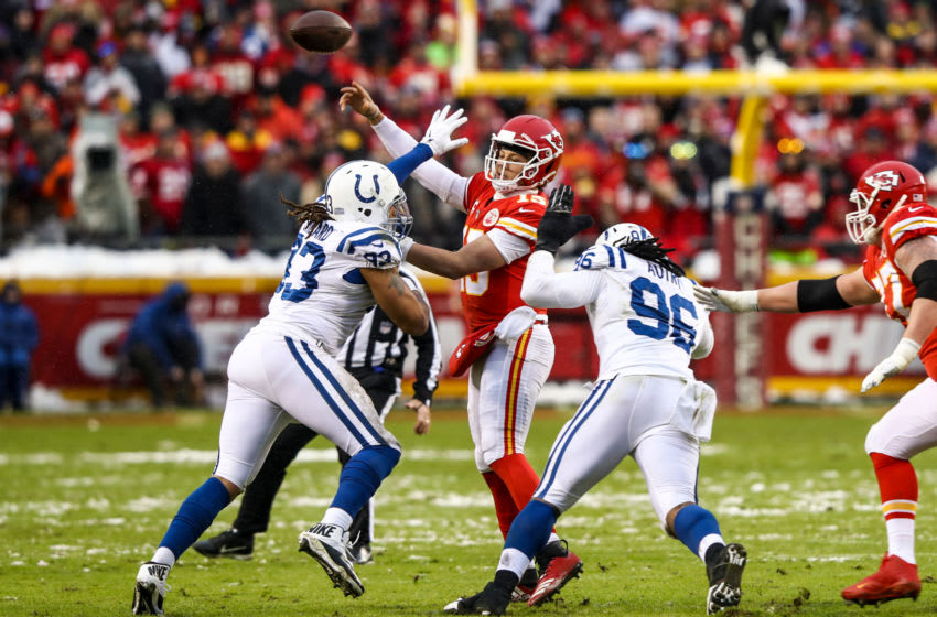 KANSAS CITY, MO - JANUARY 12: Patrick Mahomes #15 of the Kansas City Chiefs throws a pass under heavy pressure from Denico Autry #96 and teammate Jabaal Sheard #93 of the Indianapolis Colts during the first half of the AFC Divisional Round playoff game at Arrowhead Stadium on January 12, 2019 in Kansas City, Missouri. (Photo by Jamie Squire/Getty Images)
