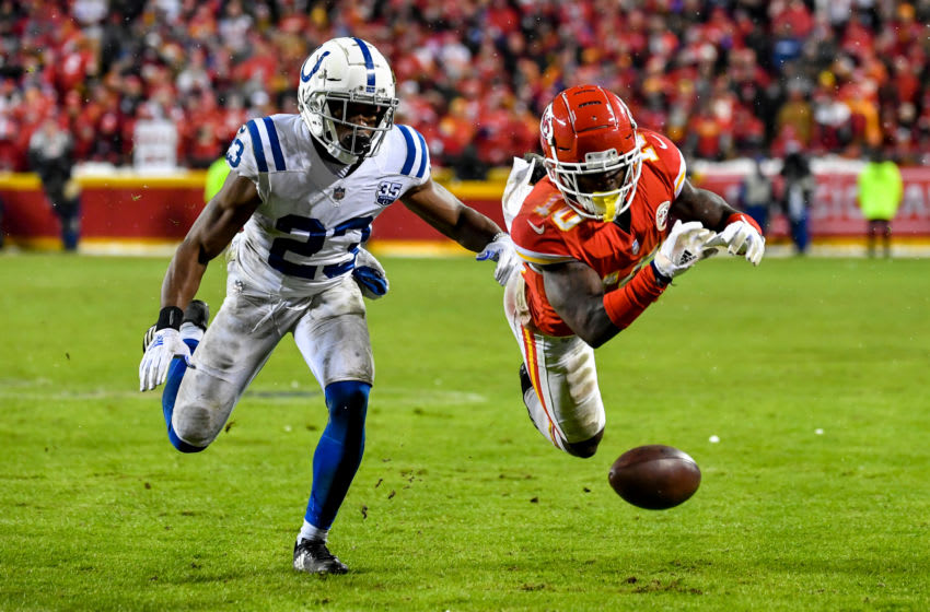 KANSAS CITY, MO - JANUARY 12: Tyreek Hill #10 of the Kansas City Chiefs dives to try and make a catch in front of Kenny Moore #23 of the Indianapolis Colts during the fourth quarter of the AFC Divisional Round playoff game at Arrowhead Stadium on January 12, 2019 in Kansas City, Missouri. (Photo by Peter Aiken/Getty Images)