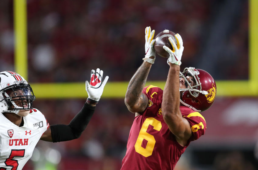 LOS ANGELES, CALIFORNIA - SEPTEMBER 20: Wide receiver Michael Pittman Jr. #6 of the USC Trojans makes a catch from quarterback Matt Fink #19 in the game against the Utah Utes at Los Angeles Memorial Coliseum on September 20, 2019 in Los Angeles, California. (Photo by Meg Oliphant/Getty Images)