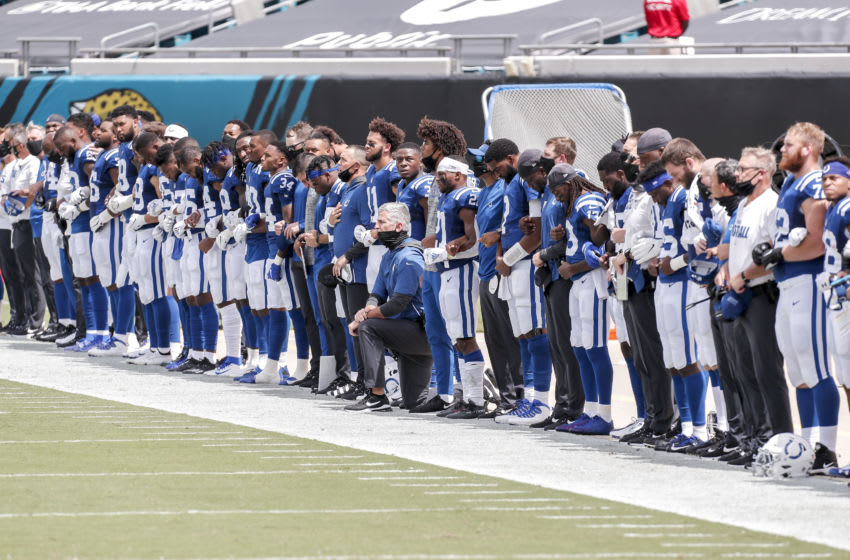 JACKSONVILLE, FL - SEPTEMBER 13: Head Coach Frank Reich of the Indianapolis Colts takes a knee during the National Anthem with his team before the start of the game against the Jacksonville Jaguars at TIAA Bank Field on September 13, 2020 in Jacksonville, Florida. The Jaguars defeated the Colts 27 to 20. (Photo by Don Juan Moore/Getty Images)