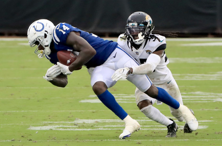 JACKSONVILLE, FLORIDA - SEPTEMBER 13: Zach Pascal #14 of the Indianapolis Colts is tackled by Tre Herndon #37 of the Jacksonville Jaguars during the game at TIAA Bank Field on September 13, 2020 in Jacksonville, Florida. (Photo by Sam Greenwood/Getty Images)