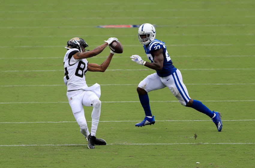 Keelan Cole #84 of the Jacksonville Jaguars makes a reception against Xavier Rhodes #27 of the Indianapolis Colts during the game at TIAA Bank Field on September 13, 2020 in Jacksonville, Florida. (Photo by Sam Greenwood/Getty Images)