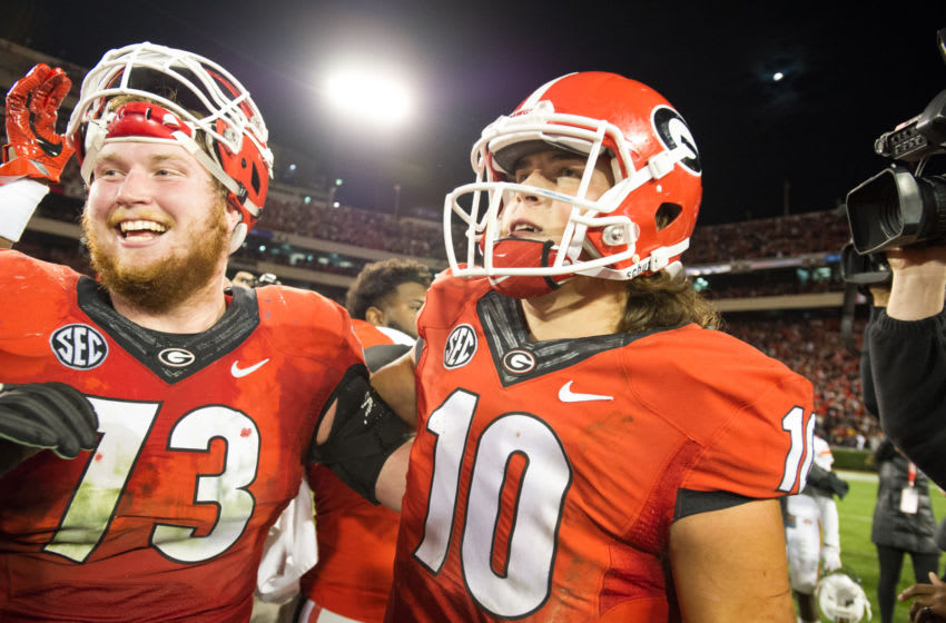 Guard Greg Pyke #73 of the Georgia Bulldogs celebrates with quarterback Jacob Eason #10 of the Georgia Bulldogs after defeating the Auburn Tigers at Sanford Stadium on November 12, 2016 in Athens, Georgia. The Georgia Bulldogs defeated the Auburn Tigers 13-7. (Photo by Michael Chang/Getty Images)