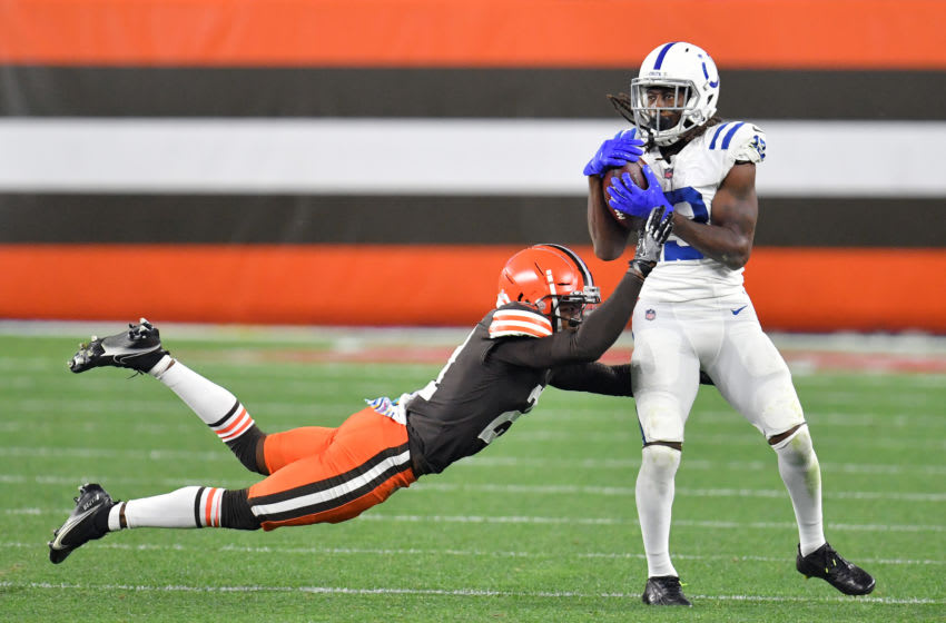 CLEVELAND, OHIO - OCTOBER 11: Cornerback Denzel Ward #21 of the Cleveland Browns tries to stop wide receiver T.Y. Hilton #13 of the Indianapolis Colts during the fourth quarter at FirstEnergy Stadium on October 11, 2020 in Cleveland, Ohio. The Browns defeated the Colts 32-23. (Photo by Jason Miller/Getty Images)