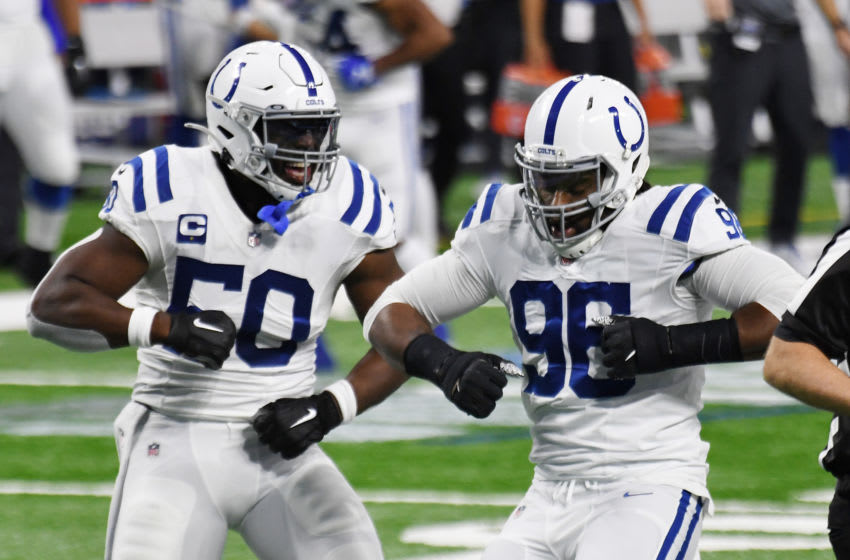 DETROIT, MICHIGAN - NOVEMBER 01: Justin Houston #50 and Denico Autry #96 of the Indianapolis Colts celebrate after a sack on third down against the Detroit Lions during the second quarter at Ford Field on November 01, 2020 in Detroit, Michigan. (Photo by Nic Antaya/Getty Images)