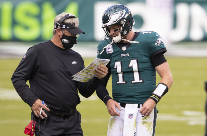 PHILADELPHIA, PA - OCTOBER 18: Head coach Doug Pederson of the Philadelphia Eagles talks to Carson Wentz #11 against the Baltimore Ravens at Lincoln Financial Field on October 18, 2020 in Philadelphia, Pennsylvania. (Photo by Mitchell Leff/Getty Images)