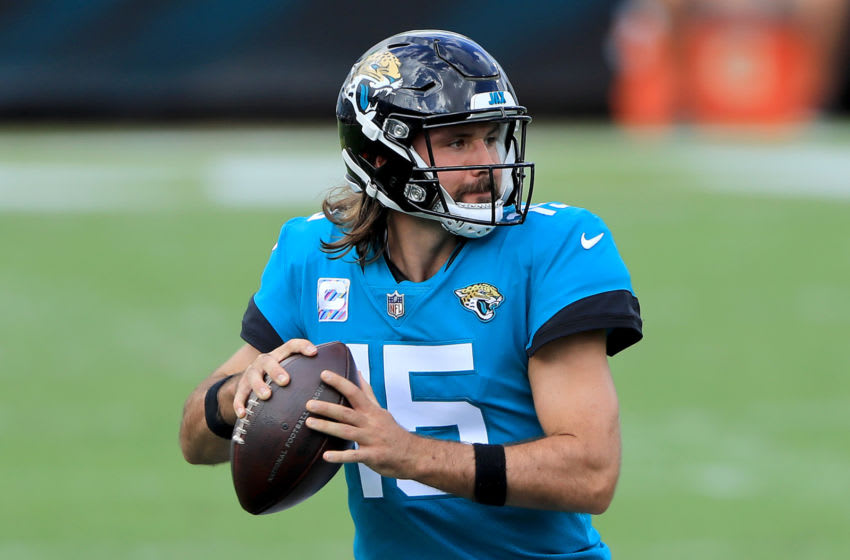 JACKSONVILLE, FLORIDA - OCTOBER 18: Gardner Minshew #15 of the Jacksonville Jaguars looks to throw a pass against the Detroit Lions during the second quarter in the game at TIAA Bank Field on October 18, 2020 in Jacksonville, Florida. (Photo by Sam Greenwood/Getty Images)