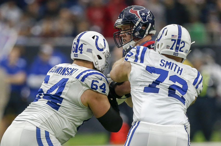 HOUSTON, TX - DECEMBER 09: J.J. Watt #99 of the Houston Texans is double teamed by Mark Glowinski #64 of the Indianapolis Colts and Braden Smith #72 at NRG Stadium on December 9, 2018 in Houston, Texas. (Photo by Bob Levey/Getty Images)