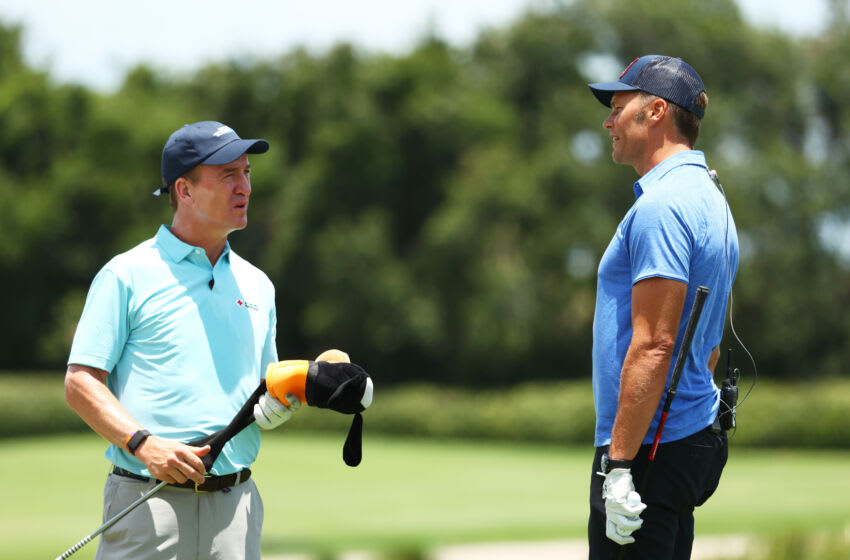 HOBE SOUND, FLORIDA - MAY 23: Former NFL player Peyton Manning (L) and NFL player Tom Brady of the Tampa Bay Buccaneers talk during a practice round for The Match: Champions For Charity at Medalist Golf Club on May 23, 2020 in Hobe Sound, Florida. (Photo by Mike Ehrmann/Getty Images for The Match)