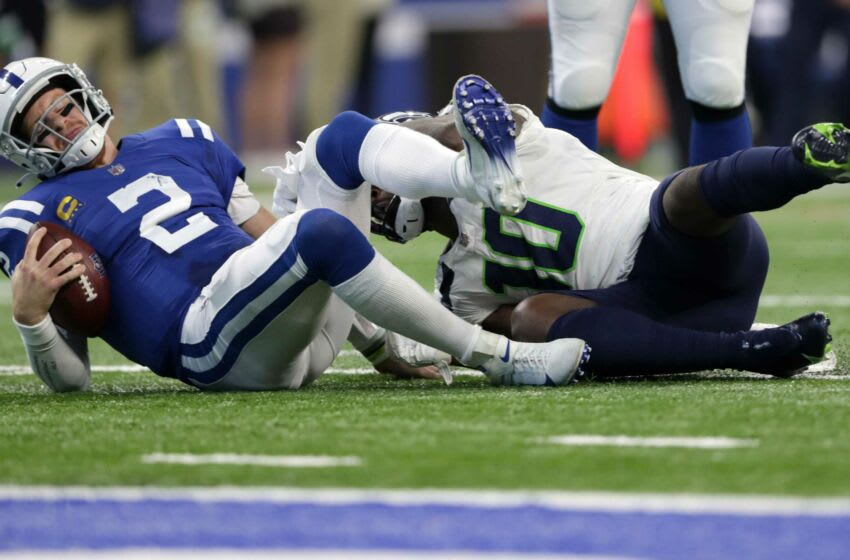 Indianapolis Colts quarterback Carson Wentz (2) is sacked by Seattle Seahawks defensive end Benson Mayowa (10) Sunday, Sept. 12, 2021, during the regular season opener at Lucas Oil Stadium in Indianapolis.