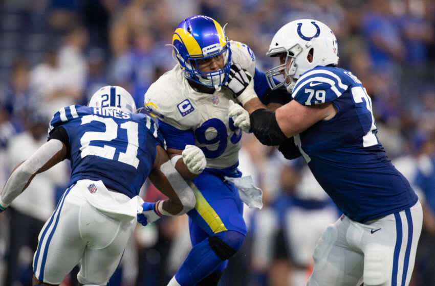 Sep 19, 2021; Indianapolis, Indiana, USA; Los Angeles Rams defensive end Aaron Donald (99) rushes the passer while Indianapolis Colts offensive tackle Eric Fisher (79) defends Mandatory Credit: Trevor Ruszkowski-USA TODAY Sports
