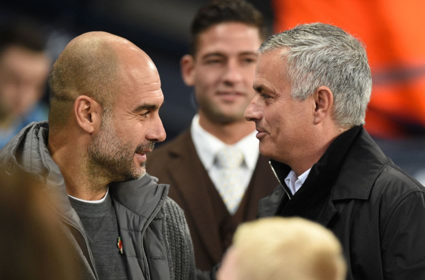 Manchester City's Spanish manager Pep Guardiola (L) greets Tottenham Portuguese manager Jose Mourinho (Photo credit should read OLI SCARFF/AFP via Getty Images)