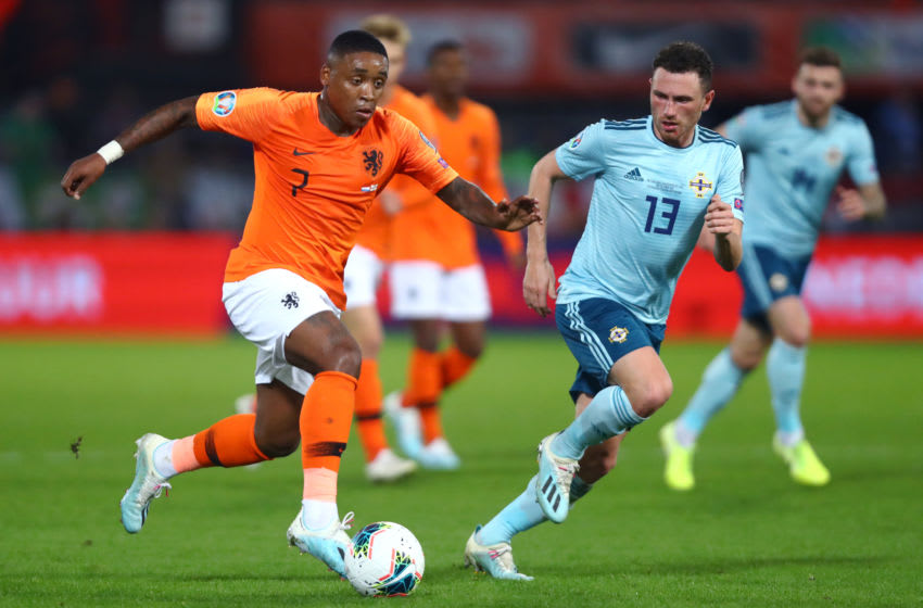 ROTTERDAM, NETHERLANDS - OCTOBER 10: Steven Bergwijn of Netherlands battles for the ball with Corry Evans of Northern Ireland during the UEFA Euro 2020 qualifier between Netherlands and Northern Ireland on October 10, 2019 in Rotterdam, Netherlands. (Photo by Dean Mouhtaropoulos/Getty Images,)