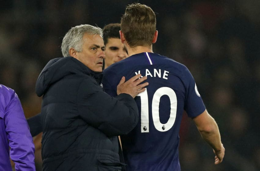 Tottenham Hotspur's Portuguese head coach Jose Mourinho (L) consoles Tottenham Hotspur's English striker Harry Kane (R) as he leaves the pitch having picked up an injury during the English Premier League football match between Southampton and Tottenham at St Mary's Stadium in Southampton, southern England on January 1, 2020. (Photo by Adrian DENNIS / AFP) / RESTRICTED TO EDITORIAL USE. No use with unauthorized audio, video, data, fixture lists, club/league logos or 'live' services. Online in-match use limited to 120 images. An additional 40 images may be used in extra time. No video emulation. Social media in-match use limited to 120 images. An additional 40 images may be used in extra time. No use in betting publications, games or single club/league/player publications. / (Photo by ADRIAN DENNIS/AFP via Getty Images)