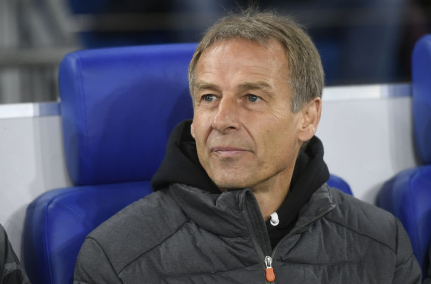 Hertha Berlin's German head coach Jurgen Klinsmann sits on the bench during the German Cup (DFB Pokal) round of 16 football match Schalke 04 v Hertha Berlin in Gelsenkirchen, westen Germany on February 4, 2020. (Photo by INA FASSBENDER / AFP) / DFB REGULATIONS PROHIBIT ANY USE OF PHOTOGRAPHS AS IMAGE SEQUENCES AND QUASI-VIDEO. (Photo by INA FASSBENDER/AFP via Getty Images)