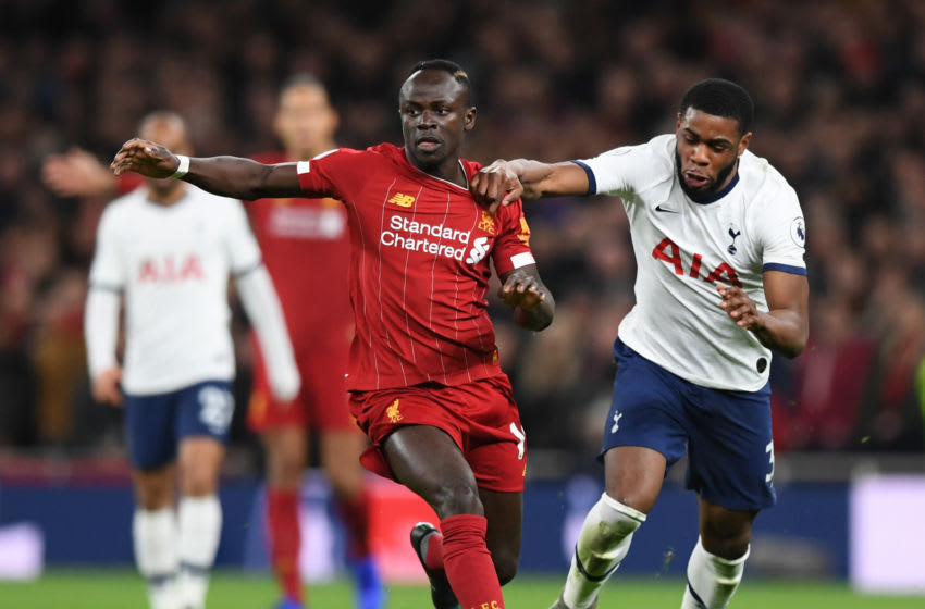 LONDON, ENGLAND - JANUARY 11: Sadio Mane of Liverpool runs with the ball from Japhet Tanganga of Tottenham Hotspur during the Premier League match between Tottenham Hotspur and Liverpool FC at Tottenham Hotspur Stadium on January 11, 2020 in London, United Kingdom. (Photo by Shaun Botterill/Getty Images)