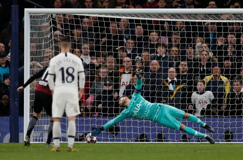 Tottenham Hotspur's French goalkeeper Hugo Lloris (R) fails to save a penalty shot from RB Leipzig's German striker Timo Werner (L) during the UEFA Champions League round of 16 first Leg football match between Tottenham Hotspur and RB Leipzig at the Tottenham Hotspur Stadium in north London, on February 19, 2020. (Photo by Adrian DENNIS / AFP) (Photo by ADRIAN DENNIS/AFP via Getty Images)