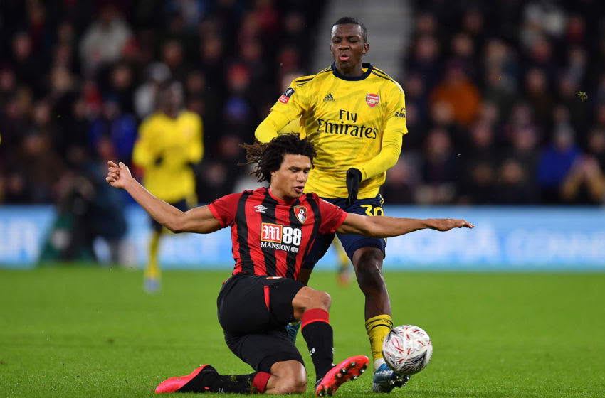 BOURNEMOUTH, ENGLAND - JANUARY 27: Edward Nketiah of Arsenal is tackled by Nathan Ake of Bournemouth during the FA Cup Fourth Round match between AFC Bournemouth and Arsenal at Vitality Stadium on January 27, 2020 in Bournemouth, England. (Photo by Justin Setterfield/Getty Images)