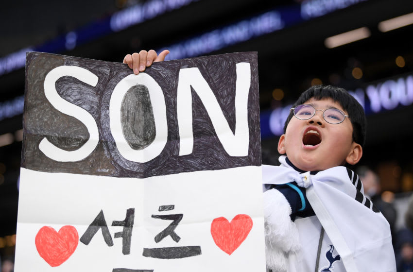 LONDON, ENGLAND - FEBRUARY 02: A Tottenham Hotspur fan holds up a home made sign for Heung-Min Son prior to the Premier League match between Tottenham Hotspur and Manchester City at Tottenham Hotspur Stadium on February 02, 2020 in London, United Kingdom. (Photo by Laurence Griffiths/Getty Images)