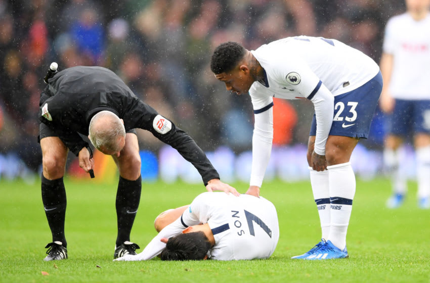 BIRMINGHAM, ENGLAND - FEBRUARY 16: Heung-Min Son of Tottenham Hotspur lies injured after being tackled by tackle by Ezri Konsa of Aston Villa during the Premier League match between Aston Villa and Tottenham Hotspur at Villa Park on February 16, 2020 in Birmingham, United Kingdom. (Photo by Laurence Griffiths/Getty Images)