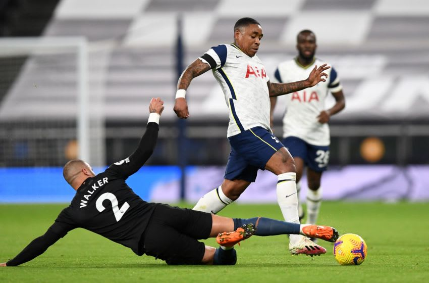 Manchester City's English defender Kyle Walker (L) vies with Tottenham Hotspur's Steven Bergwijn, on November 21, 2020. (Photo by NEIL HALL/POOL/AFP via Getty Images)