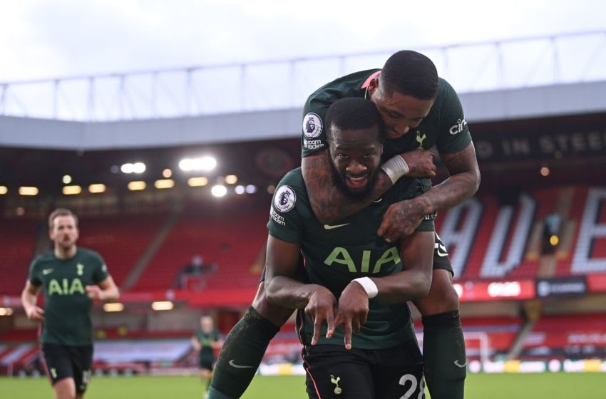Tottenham Hotspur's French midfielder Tanguy Ndombele (front) celebrates scoring his team's third goal with Tottenham Hotspur's Dutch midfielder Steven Bergwijn (top) during the English Premier League football match between Sheffield United and Tottenham Hotspur at Bramall Lane in Sheffield, northern England on January 17, 2021. (Photo by Laurence Griffiths / POOL / AFP) / RESTRICTED TO EDITORIAL USE. No use with unauthorized audio, video, data, fixture lists, club/league logos or 'live' services. Online in-match use limited to 120 images. An additional 40 images may be used in extra time. No video emulation. Social media in-match use limited to 120 images. An additional 40 images may be used in extra time. No use in betting publications, games or single club/league/player publications. / (Photo by LAURENCE GRIFFITHS/POOL/AFP via Getty Images)