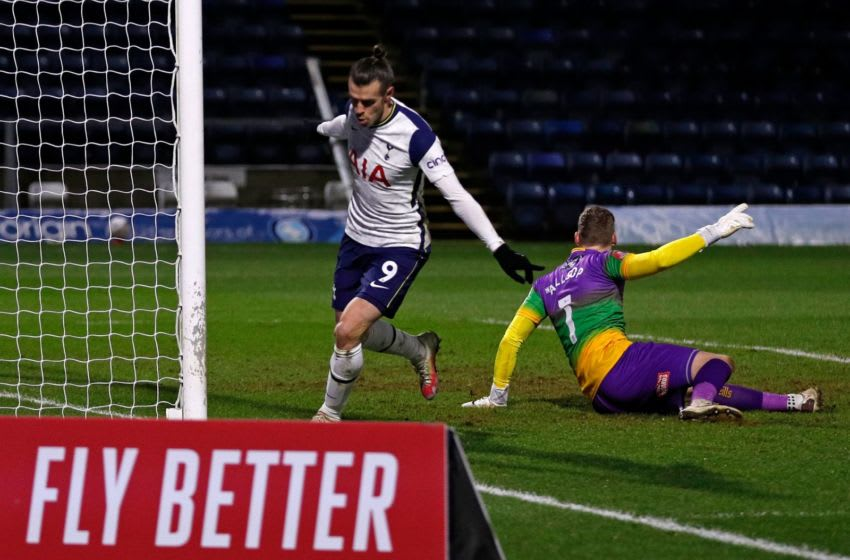 Tottenham Hotspur's Welsh striker Gareth Bale (R) celebrates after scoring their first goal during the English FA Cup fourth round football match between Wycombe Wanderers and Tottenham Hotspur at Adams Park Stadium in High Wycombe, west of London on January 25, 2021. (Photo by ADRIAN DENNIS/AFP via Getty Images)