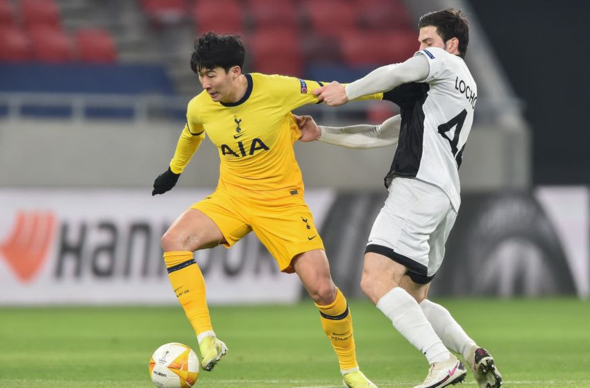Tottenham Hotspur's South Korean striker Son Heung-Min (L) and Wolfsberg's Georgian defender Luka Lochoshvili vie for the ball during the UEFA Europa League, last-32 first leg football match Wolfsberger AC v Tottenham Hotspur at the Puskas Arena in Budapest on February 18, 2021. (Photo by Attila KISBENEDEK / AFP) (Photo by ATTILA KISBENEDEK/AFP via Getty Images)
