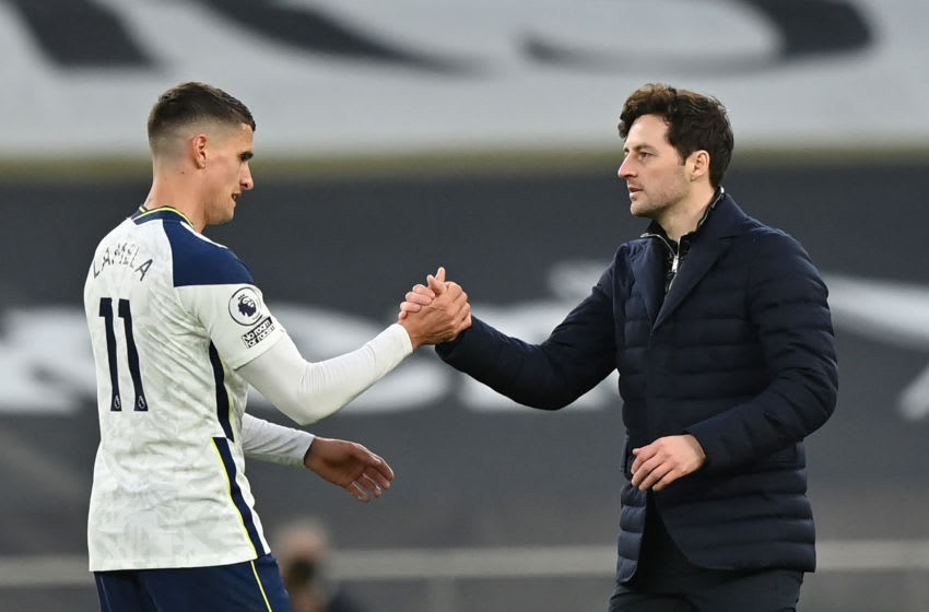 Tottenham Hotspur's head coach Ryan Mason (R) reacts with Tottenham Hotspur's Argentinian midfielder Erik Lamela at the final whistle during the English Premier League football match between Tottenham Hotspur and Southampton at Tottenham Hotspur Stadium in north London on April 21, 2021. - - RESTRICTED TO EDITORIAL USE. No use with unauthorized audio, video, data, fixture lists, club/league logos or 'live' services. Online in-match use limited to 120 images. An additional 40 images may be used in extra time. No video emulation. Social media in-match use limited to 120 images. An additional 40 images may be used in extra time. No use in betting publications, games or single club/league/player publications. (Photo by Justin Setterfield / POOL / AFP) / RESTRICTED TO EDITORIAL USE. No use with unauthorized audio, video, data, fixture lists, club/league logos or 'live' services. Online in-match use limited to 120 images. An additional 40 images may be used in extra time. No video emulation. Social media in-match use limited to 120 images. An additional 40 images may be used in extra time. No use in betting publications, games or single club/league/player publications. / RESTRICTED TO EDITORIAL USE. No use with unauthorized audio, video, data, fixture lists, club/league logos or 'live' services. Online in-match use limited to 120 images. An additional 40 images may be used in extra time. No video emulation. Social media in-match use limited to 120 images. An additional 40 images may be used in extra time. No use in betting publications, games or single club/league/player publications. (Photo by JUSTIN SETTERFIELD/POOL/AFP via Getty Images)
