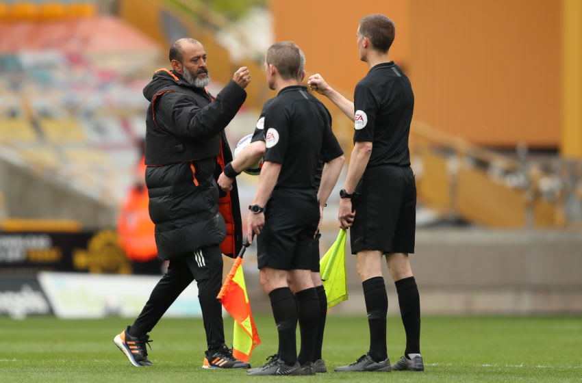 WOLVERHAMPTON, ENGLAND - MAY 09: Nuno Espirito Santo the head coach / manager of Wolverhampton Wanderers fist bumps the officials at full time during the Premier League match between Wolverhampton Wanderers and Brighton & Hove Albion at Molineux on May 9, 2021 in Wolverhampton, United Kingdom.. (Photo by James Williamson - AMA/Getty Images)