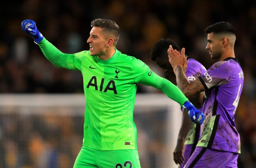 Tottenham Hotspur's Italian goalkeeper Pierluigi Gollini celebrates after a penalty shoot out during the English League Cup third round football match between Wolverhampton Wanderers and Tottenham Hotspur at the Molineux stadium in Wolverhampton, central England on September 22, 2021. - (Photo by LINDSEY PARNABY/AFP via Getty Images)