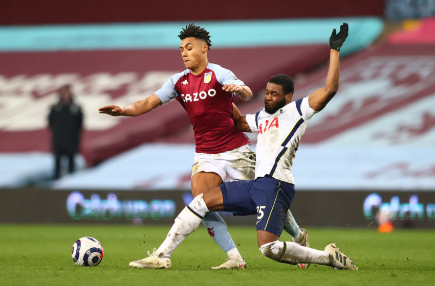 BIRMINGHAM, ENGLAND - MARCH 21: Ollie Watkins of Aston Villa is challenged by Japhet Tanganga of Tottenham Hotspur during the Premier League match between Aston Villa and Tottenham Hotspur at Villa Park on March 21, 2021 in Birmingham, England. Sporting stadiums around England remain under strict restrictions due to the Coronavirus Pandemic as Government social distancing laws prohibit fans inside venues resulting in games being played behind closed doors. (Photo by Michael Steele/Getty Images)