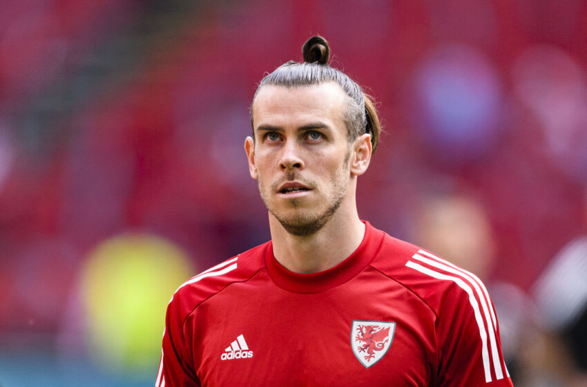 AMSTERDAM, NETHERLANDS - JUNE 26: Gareth Bale of Wales warming up during the UEFA Euro 2020 Championship Round of 16 match between Wales and Denmark at Johan Cruijff Arena on June 26, 2021 in Amsterdam, Netherlands. (Photo by Marcio Machado/Eurasia Sport Images/Getty Images)