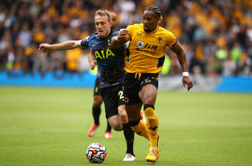 WOLVERHAMPTON, ENGLAND - AUGUST 22: Adama Traore of Wolverhampton Wanderers in action with Oliver Skipp of Tottenham Hotpsur during the Premier League match between Wolverhampton Wanderers and Tottenham Hotspur at Molineux on August 22, 2021 in Wolverhampton, England. (Photo by Chris Brunskill/Fantasista/Getty Images)
