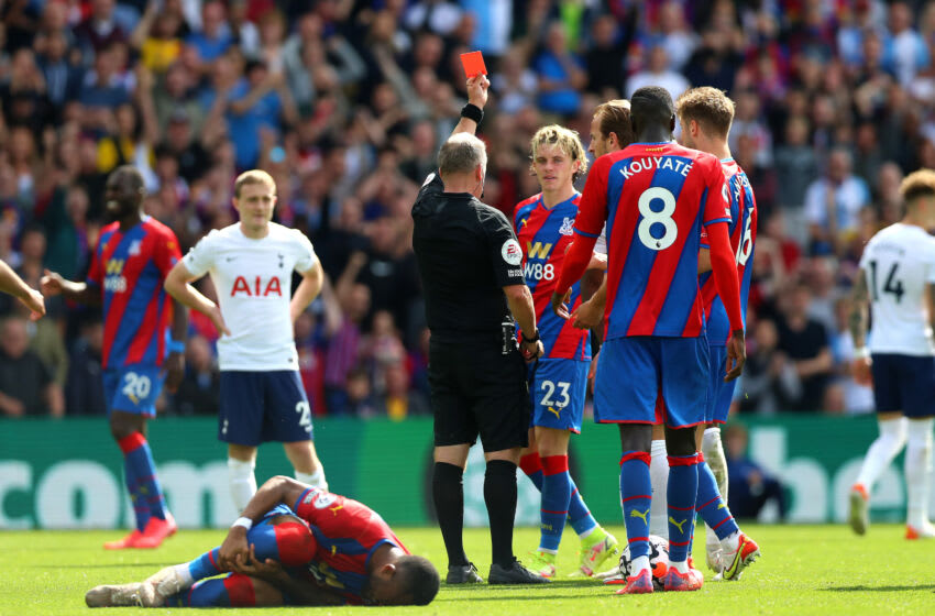 LONDON, ENGLAND - SEPTEMBER 11: Japhet Tanganga of Tottenham Hotspur (obscured) is awarded a red card during the Premier League match between Crystal Palace and Tottenham Hotspur at Selhurst Park on September 11, 2021 in London, England. (Photo by Chloe Knott - Danehouse/Getty Images)