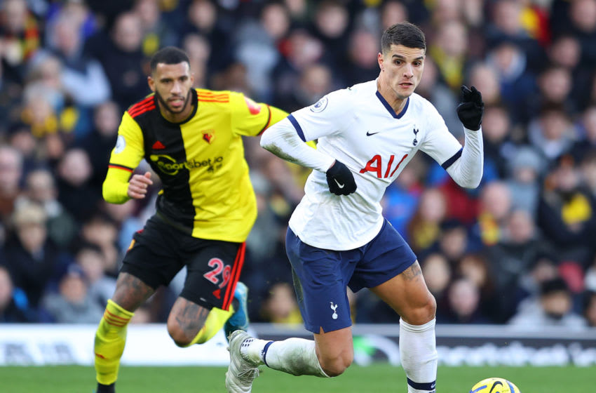 WATFORD, ENGLAND - JANUARY 18: Erik Lamela of Tottenham breaks past Étienne Capoue of Watford during the Premier League match between Watford FC and Tottenham Hotspur at Vicarage Road on January 18, 2020 in Watford, United Kingdom. (Photo by Richard Heathcote/Getty Images)