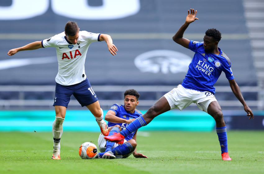 LONDON, ENGLAND - JULY 19: Giovani Lo Celso of Tottenham Hotspur battles for possession with Wilfred Ndidi of Leicester City during the Premier League match between Tottenham Hotspur and Leicester City at Tottenham Hotspur Stadium on July 19, 2020 in London, England. Football Stadiums around Europe remain empty due to the Coronavirus Pandemic as Government social distancing laws prohibit fans inside venues resulting in all fixtures being played behind closed doors. (Photo by Richard Heathcote/Getty Images)