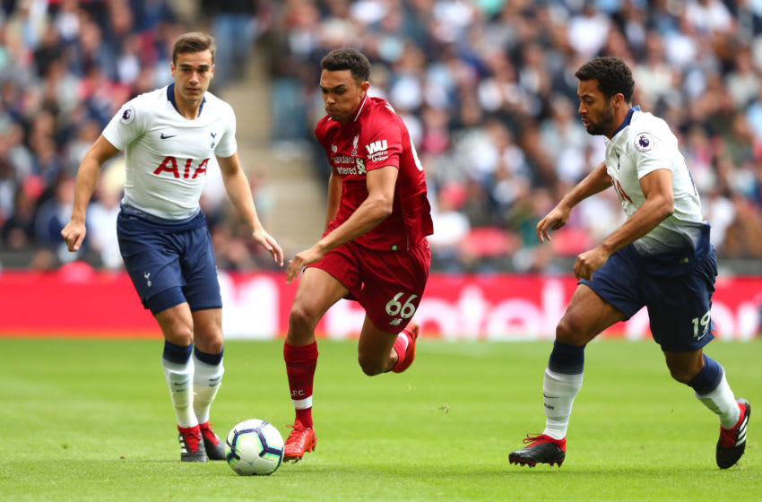 LONDON, ENGLAND - SEPTEMBER 15: Harry Winks and Mousa Dembele of Tottenham Hotspur put pressure on Trent Alexander-Arnold of Liverpool during the Premier League match between Tottenham Hotspur and Liverpool FC at Wembley Stadium on September 15, 2018 in London, United Kingdom. (Photo by Clive Rose/Getty Images)
