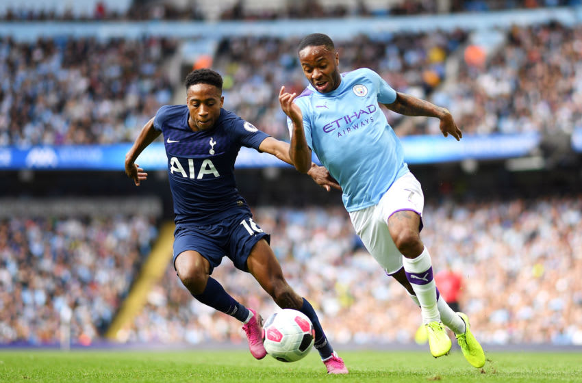 MANCHESTER, ENGLAND - AUGUST 17: Raheem Sterling of Manchester City battles for possession with Kyle Walker-Peters of Tottenham Hotspur during the Premier League match between Manchester City and Tottenham Hotspur at Etihad Stadium on August 17, 2019 in Manchester, United Kingdom. (Photo by Shaun Botterill/Getty Images)