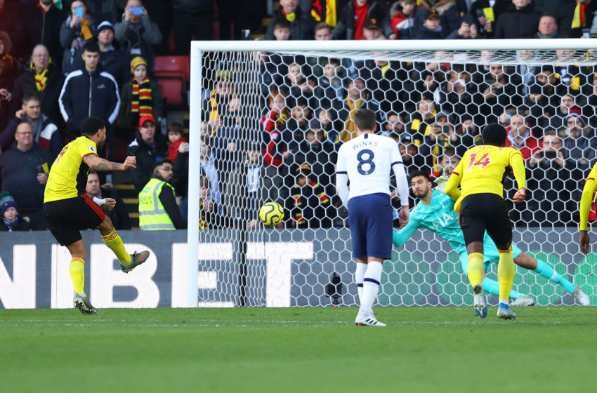 WATFORD, ENGLAND - JANUARY 18: Paulo Gazzaniga of Tottenham Hotspur saves the penalty from Troy Deeney of Watford during the Premier League match between Watford FC and Tottenham Hotspur at Vicarage Road on January 18, 2020 in Watford, United Kingdom. (Photo by Richard Heathcote/Getty Images)