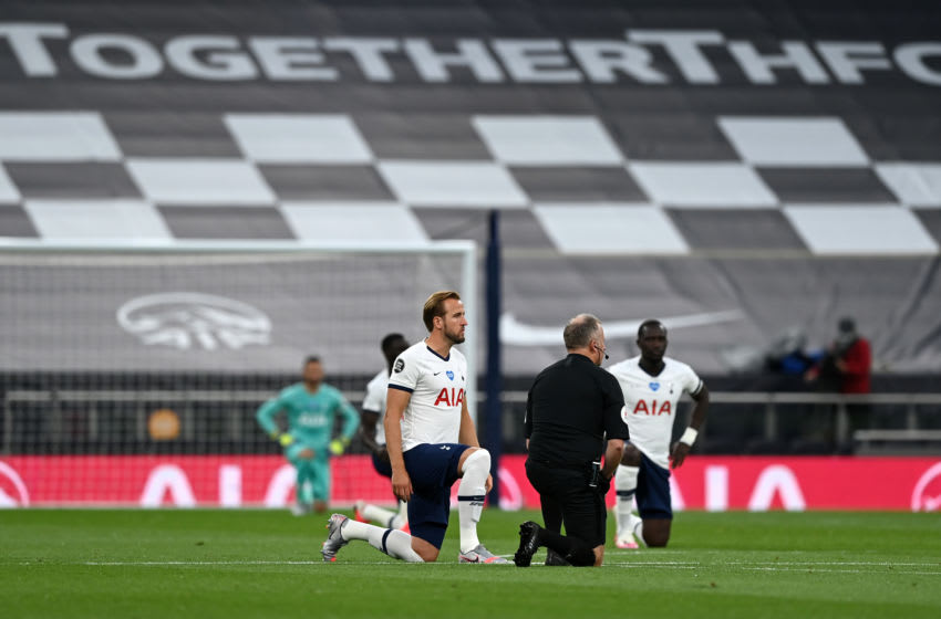 LONDON, ENGLAND - JUNE 19: Harry Kane of Tottenham Hotspur takes a knee in support of the Black Lives Matter movement prior to the Premier League match between Tottenham Hotspur and Manchester United at Tottenham Hotspur Stadium on June 19, 2020 in London, England. (Photo by Shaun Botterill/Getty Images)