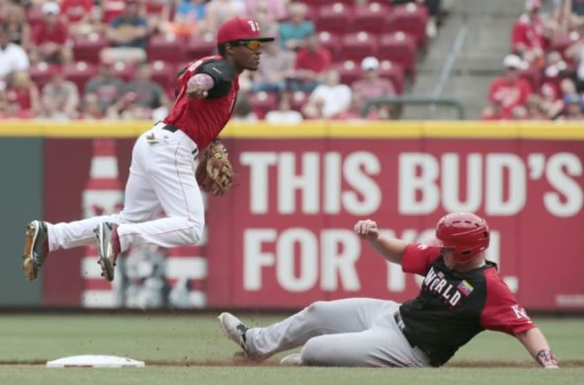 Jul 12, 2015; Cincinnati, OH, USA; USA infielder Tony Kemp (left) throws to first as World infielder Ketel Marte (right) is forced out at second base during the All Star Futures Game at Great American Ballpark. Mandatory Credit: David Kohl-USA TODAY Sports