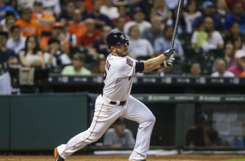 Sep 1, 2015; Houston, TX, USA; Houston Astros catcher Max Stassi (12) hits an RBI single during the second inning against the Seattle Mariners at Minute Maid Park. Mandatory Credit: Troy Taormina-USA TODAY Sports
