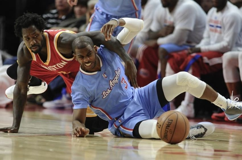 Mar 15, 2015; Los Angeles, CA, USA; Los Angeles Clippers guard Chris Paul (3) and Houston Rockets guard Patrick Beverley (2) compete for a loose ball on the floor during the second quarter at Staples Center. Mandatory Credit: Robert Hanashiro-USA TODAY Sports