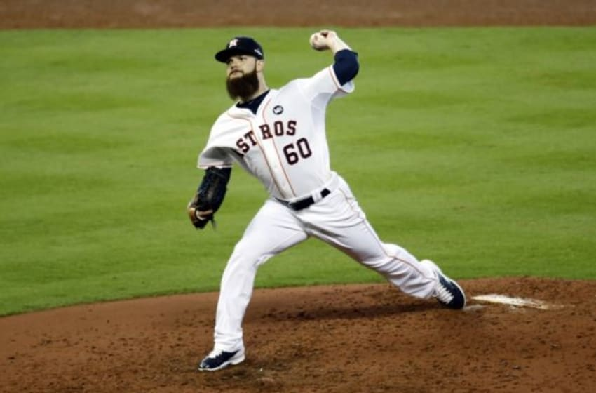 Oct 11, 2015; Houston, TX, USA; Houston Astros starting pitcher Dallas Keuchel (60) throws against the Kansas City Royals during the sixth inning in game three of the ALDS at Minute Maid Park. Mandatory Credit: Thomas B. Shea-USA TODAY Sports