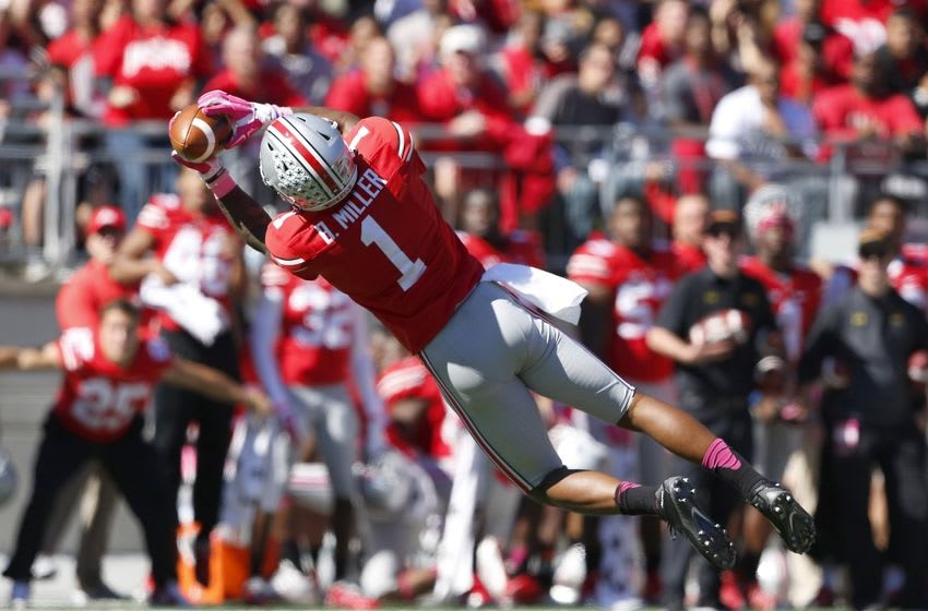 Oct 10, 2015; Columbus, OH, USA; Ohio State Buckeyes wide receiver Braxton Miller (1) makes the diving catch during the second quarter versus the Maryland Terrapins at Ohio Stadium. Mandatory Credit: Joe Maiorana-USA TODAY Sports
