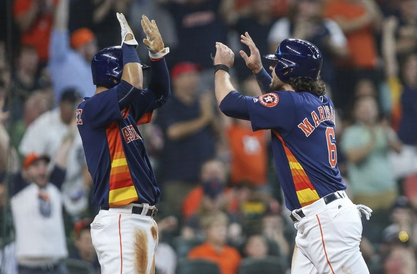 Apr 17, 2016; Houston, TX, USA; Houston Astros left fielder Jake Marisnick (6) celebrates with shortstop Marwin Gonzalez (9) after scoring a run during the fourth inning against the Detroit Tigers at Minute Maid Park. Mandatory Credit: Troy Taormina-USA TODAY Sports
